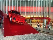 Different Ferrari cars displayed at the entrance plaza