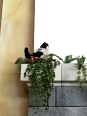 Animatronic cat on the wall