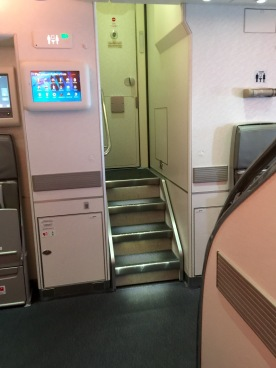 Washroom stairs at very front of the airplane
